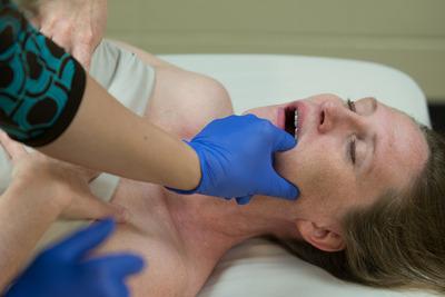 massaging the jaw muscle masseter
