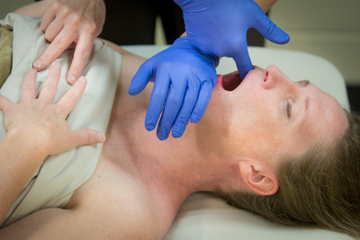 TMJ massage inside of the mouth to release jaw muscles